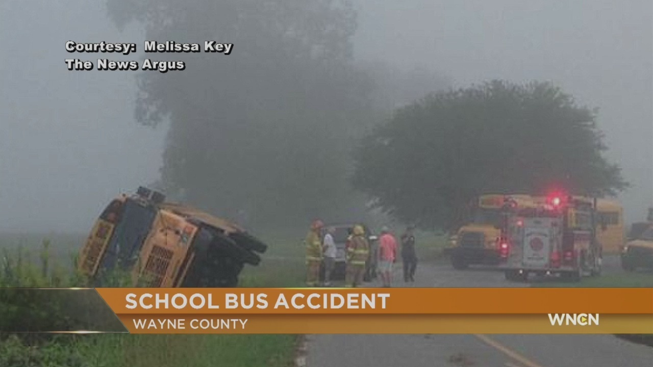 Bus driver charged after Wayne County school bus flips over