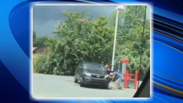 Picture of elderly NC man cleaning tires as caregiver watches sparks outrage on Facebook