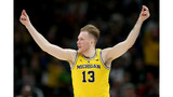 Michigan routs Montana to reach round of 32